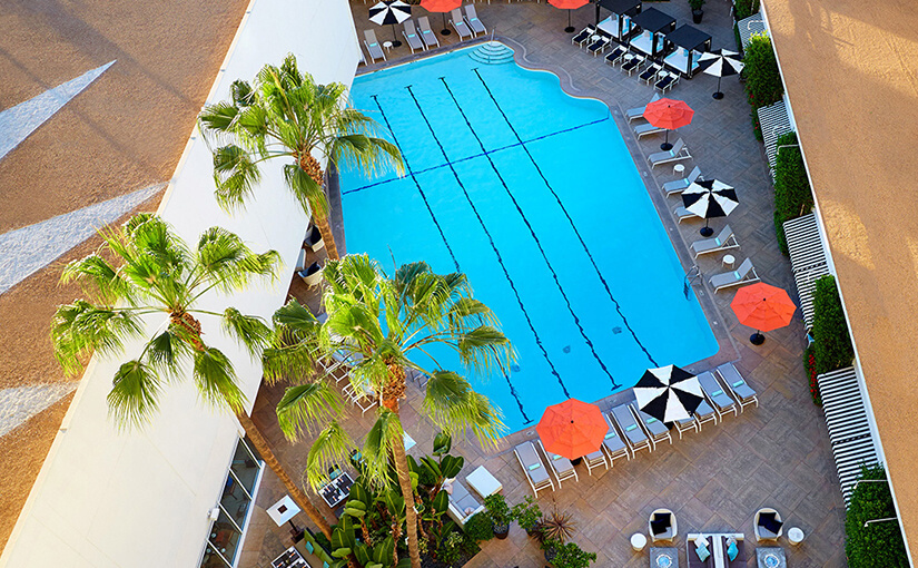 beverly-hilton-pool- bold luxury travel canada